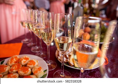 Champagne glasses on table. Celebration concept. Alcohol and cocktail party.