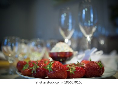 Champagne glasses on the table, champaign and strawberry. High quality photo