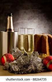 Champagne Glasses on wooden table  with christmas ornaments