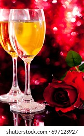 Champagne glasses with red rose