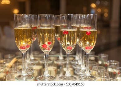 Champagne in glasses served for a banquet, a buffet table
