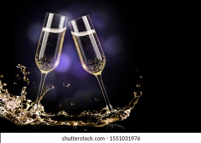 champagne glasses with splash on black background - new year celebration