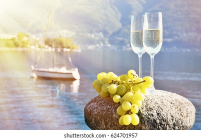 Champagne and grapes. Lake Maggiore, Switzerland