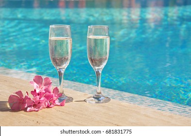 champagne on the background of the pool