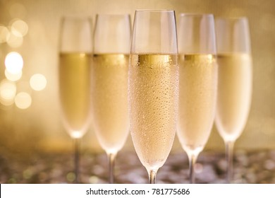 Champagne on gold background.Selective focus.