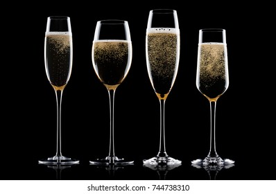 Champagne pink rose glasses with bubbles on black background. Different type of glasses.