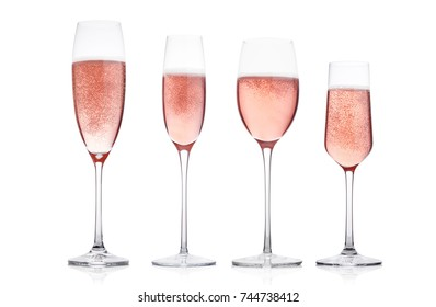 Champagne pink rose glasses with bubbles on white background. Different type of glasses.