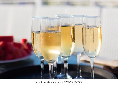 Champagne is poured in glasses