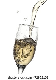 Champagne pouring into a glass with drops and bubbles