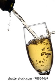 Champagne pouring into a glass form a bottle