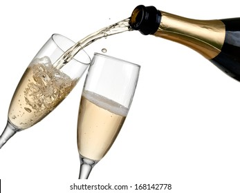 Champagne pouring in two glasses from a bottle