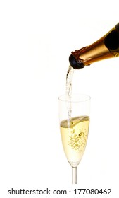 Champagne pouring in wineglass. Isolated on white background