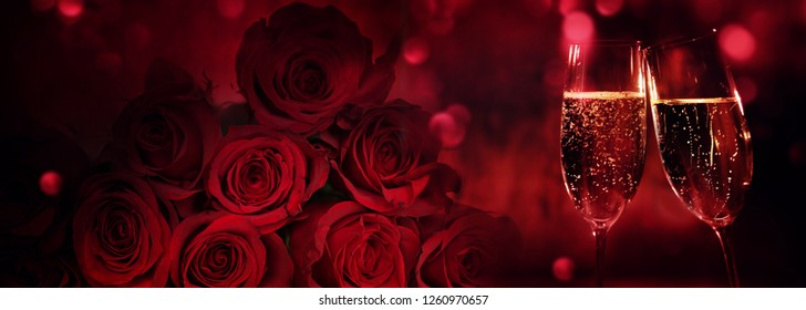 Champagne and red roses with bokeh for valentines day