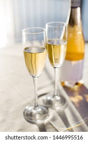 Champagne for romantic celebrations and enjoy for special moments. Two romantic glasses of sparkling champagne alongside a bottle in copy space to celebrate a wedding, anniversary, New year