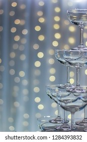 champagne saucer tower at wedding party bokeh background
