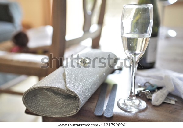 Champagne and sparkly clutch bag