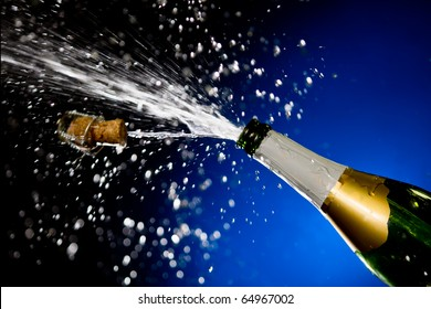 Champagne splash. Bottle and cork, celebration time