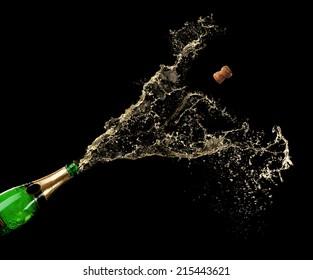 Champagne splashes on black background
