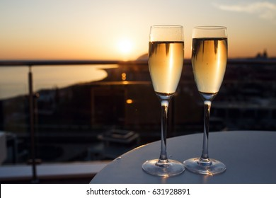 The champagne stand on the table. Sea view and sunset