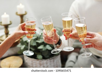 Champagne toast. People holding glass of champagne