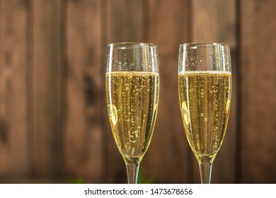 champagne in transparent glasses and a bottle (New Year's atmosphere, Christmas) of happy holidays! top food background. copy space