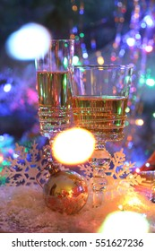 champagne in transparent glasses, Christmas table decoration