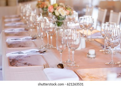 Champagne and wine glasses on a decorated table at wedding reception