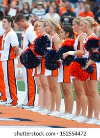 CHAMPAIGN,IL-AUGUST 31: Illinois cheerleaders line the end zone just prior to the game against SIU on Saturday, Aug 31, 2013.