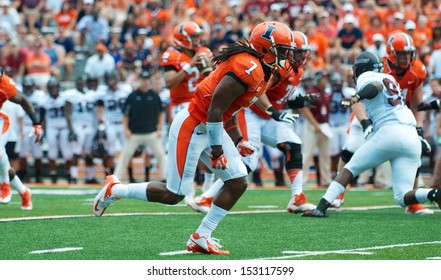 CHAMPAIGN,IL-AUGUST 31: Illinois wide receiver Martize Barr (7) moves into position to receive a pass from quarterback Nathan Sheelhaase (2) on Saturday, Aug 31, 2013.