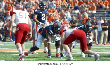 CHAMPAIGN,IL-SEPTEMBER 28: Illinois quarterback Nathan Scheelhaase (2) prepares to receive the snap during the first quarter of a game against Miami-OH on Saturday, Sept 28, 2013.