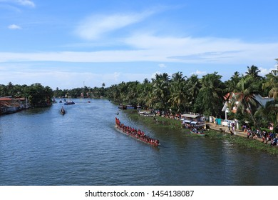 CHAMPAKKULAM, INDIA - JULY 15: Top view of a snake boat team competes in the Champakkulam Moolam Boat race held on July 15, 2019 in Champakkulam, Kerala, India.