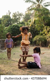 CHAMPASAK, LAOS - FEBRUARY 26 : Unidentified Children of Laos play and fun of kids in countryside village on FEBRUARY 26, 2011 in Champasak, Laos