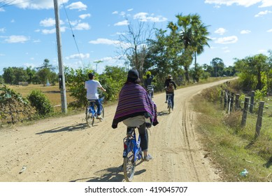 CHAMPASAK, LAOS - MAY 9: The Laos Local Field on MAY 9, 2016, in Champasak, Laos.Young tourists cycling trip in Laos .