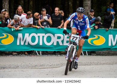 CHAMPERY, SEPTEMBER 3: Unidentified Italian team Mountain-Bike competitor reaching for the finish line during the UCI Mountain-Bike world championships on 3 September 2011, Champery, Switzerland.