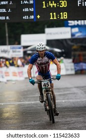 CHAMPERY, SEPTEMBER 3: Unidentified USA Mountain-Biker reaches the finish line during the UCI Mountain-Bike world championships on 3 September 2011, Champery, Switzerland.