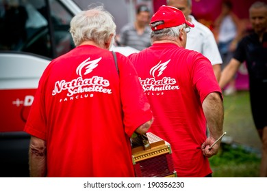 CHAMPERY, SWITZERLAND, SEPTEMBER 20: Two unidentified fans wear a Nathalie Schneitter fanclub tshirt. Nathalie is a cross-country athlete and races since 2000.