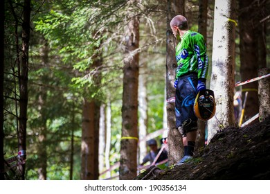 CHAMPERY, SWITZERLAND - SEPTEMBER 20: An unidentified biker waits for the others participants to pass by so that he can retrieve his lost bike.