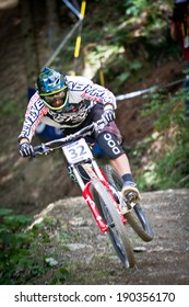 CHAMPERY, SWITZERLAND - SEPTEMBER 20: An unidentified biker as he competes at the UCI downhill world championships 2011.