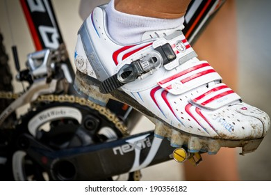 CHAMPERY, SWITZERLAND - SEPTEMBER 21: Close up of a unidentified biker as pedals at the UCI downhill world championships 2011.