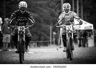 CHAMPERY, SWITZERLAND, SEPTEMBER 21 : French world record holders in DH MTB riding heading towards starting line before their run at the international downhill world championships on September 21 2011