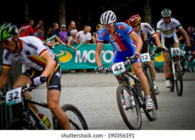 CHAMPERY, SWITZERLAND, SEPTEMBER 21: A group of unidentified bikers as they compete at the UCI downhill world championships 2011.