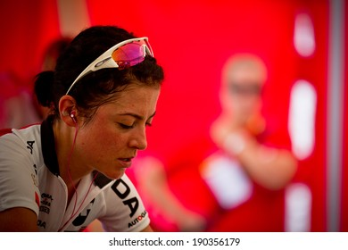 CHAMPERY, SWITZERLAND - SEPTEMBER 21: Portrait of an unidentified biker as she warms up before the beginning of the UCI downhill world championships in 2011.