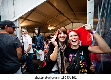CHAMPERY, SWITZERLAND - SEPTEMBER 21: Two unidentified woman celebrating under the rain during the UCI downhill world championships 2011.