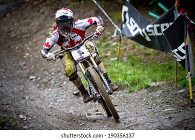 CHAMPERY, SWITZERLAND, SEPTEMBER 21: An unidentified biker as he competes at the UCI downhill world championships 2011.
