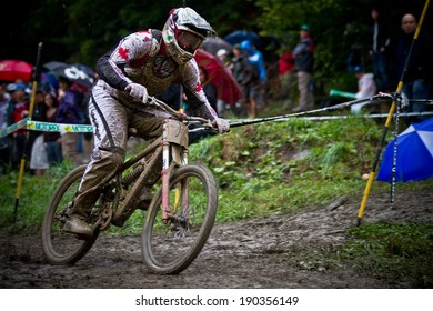 CHAMPERY, SWITZERLAND - SEPTEMBER 21: An unidentified rider completing his final run during the final of the champery UCI downhill world championships 2011.