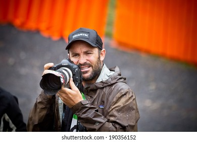 CHAMPERY, SWITZERLAND. SEPTEMBER 21: An unidentified photographer as he takes a photograph of a biker at the UCI downhill world championships 2011.