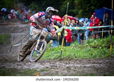 CHAMPERY, SWITZERLAND - SEPTEMBER 21: An unidentified biker as he competes at the UCI downhill world championships 2011.