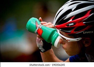 CHAMPERY, SWITZERLAND �¢?? SEPTEMBER 21: An unidentified biker as he drinks while he races at the UCI downhill world championships 2011.