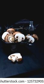 Champignon mushroom on the dark table moody