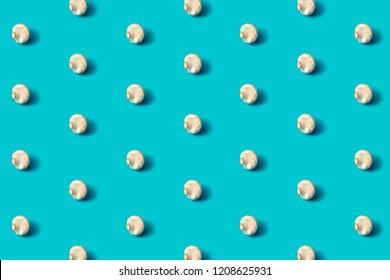 Champignon mushroom pattern on a blue background, flat lay. Top view.